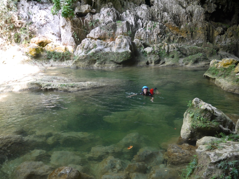 in the water - mum coming out of the cave #