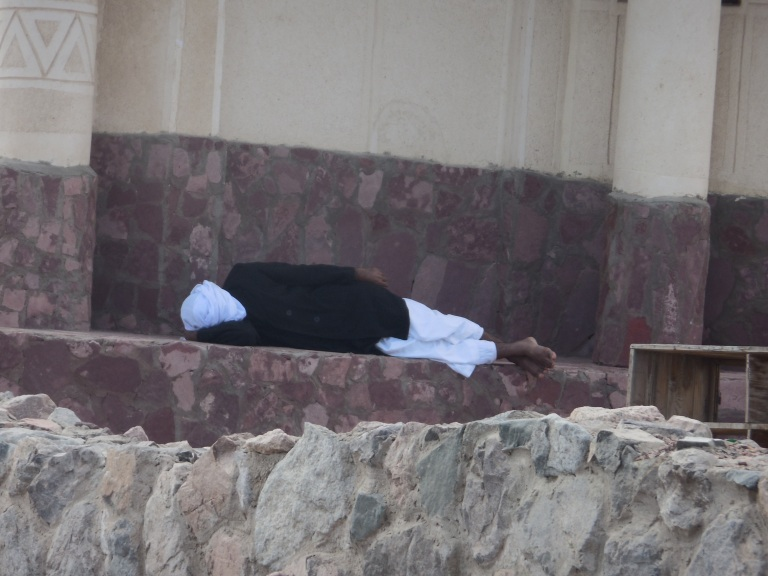 Man outside a building asleep - Travellingminstrel #