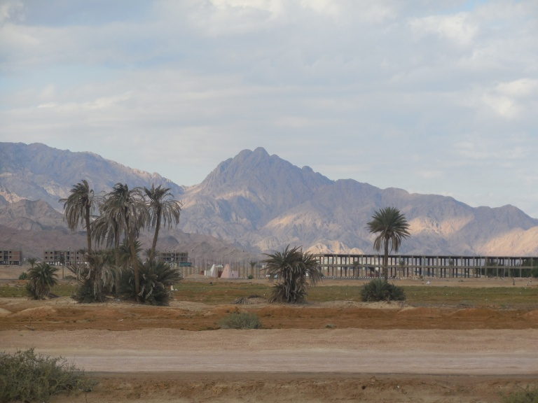 The mountains with semi-concrete houses infront of them - Travellingminstrel #