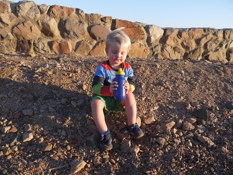 Jed chilling on the beach whilst we fly the kite - Travellingminstrel #